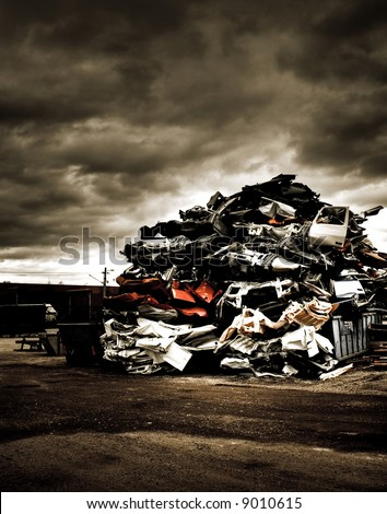 Pile of discarded cars on junkyard - stock photo