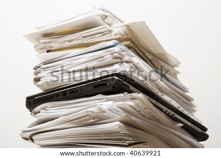 Pile of documents and the laptop - stock photo