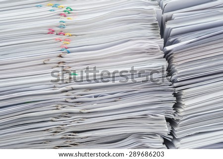 Pile of documents on desk stack up high - stock photo