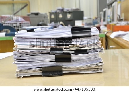 Pile of documents place on desk in office - stock photo
