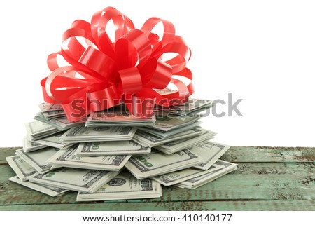 Pile of dollars with bow as gift isolated on white - stock photo
