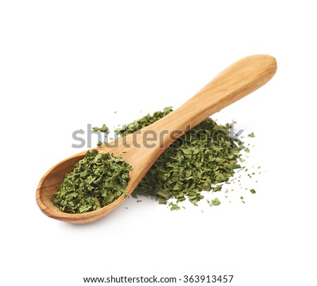 Pile of dried coriander isolated - stock photo