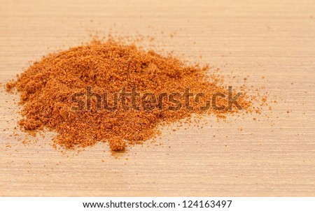 Pile of dried paprika  on wooden worktop - stock photo