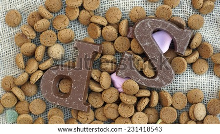 Pile of Dutch Pepernoten and chocolate, typical Dutch treat for Sinterklaas on 5 december - stock photo