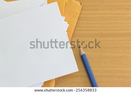 pile of envelope and pencil with  free space for text - stock photo