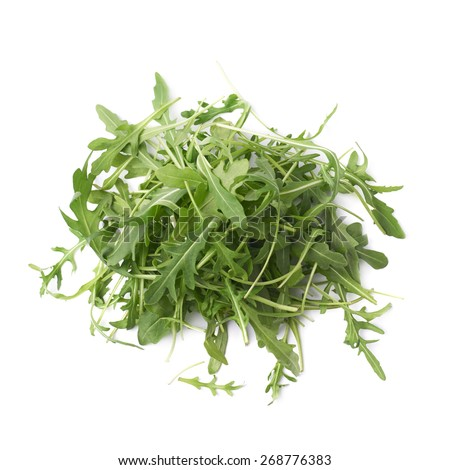 Pile of eruca sativa rucola arugula fresh green rocket salad leaves, composition isolated over the white background - stock photo