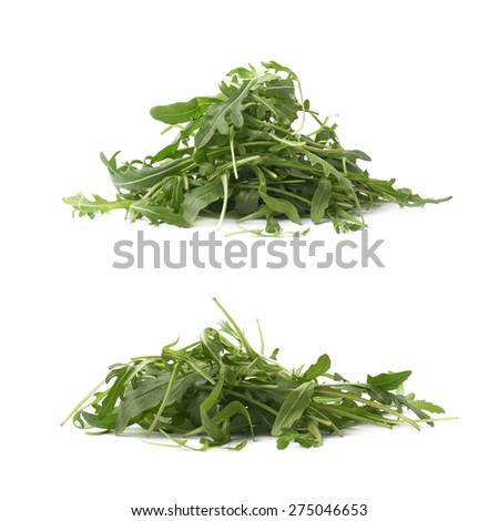 Pile of eruca sativa rucola arugula fresh green rocket salad leaves, composition isolated over the white background, set of two different foreshortenings - stock photo