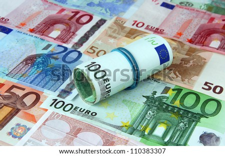 Pile of euro currency bank notes background - stock photo