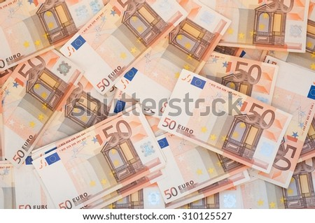 Pile of 50 euro notes - business background - stock photo
