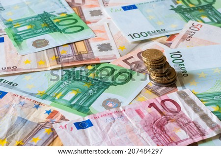Pile of Euros and stack of coins for business and finance. European money illustrating different concepts such as banking, investment, debt, economy or savings - stock photo