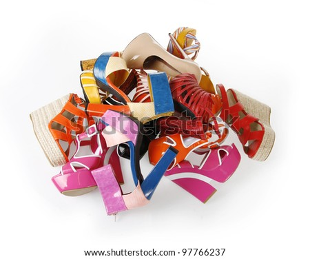 pile of female shoes on white background - stock photo