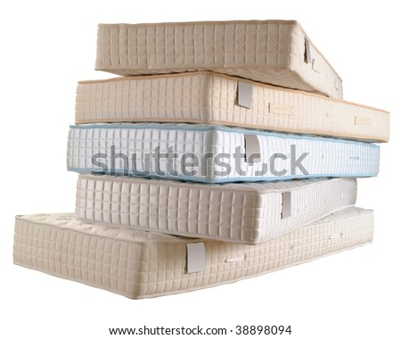 Pile of five new mattresses isolated on white - stock photo