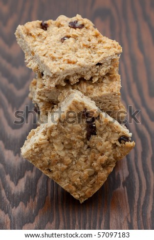 Pile of flapjack squares on a wooden board - stock photo