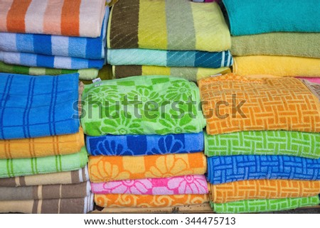 Pile of folded colorful clothes - stock photo