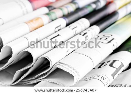 Pile of folded old newspapers - stock photo
