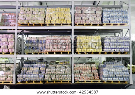 Pile of food production stacked in warehouse - stock photo