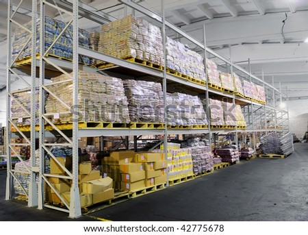 Pile of food production stacked in warehouse shelves - stock photo