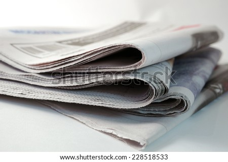 pile of four daily newspapers - stock photo