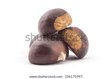 Pile of four fresh organic chestnuts isolated on white background - stock photo