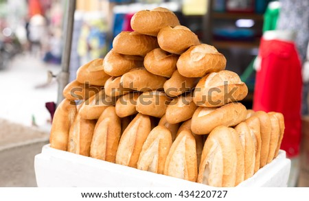 Pile of French baguette bread in white box in the market - stock photo
