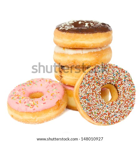 pile of fresh  donuts isolated on white background - stock photo