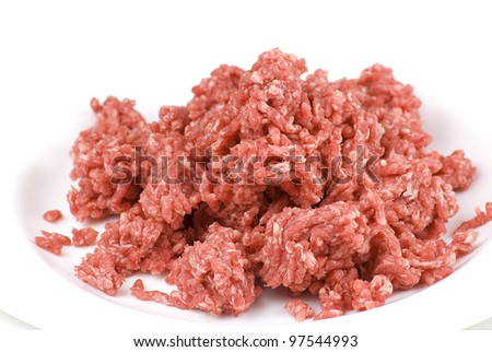 pile of fresh raw beef mince in white plate - stock photo