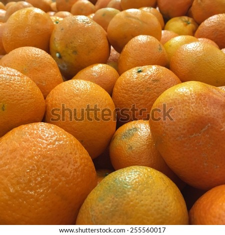 Pile of fresh tangerines oranges in market box - stock photo