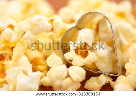 Pile of fresh tasty popcorn in closeup - stock photo
