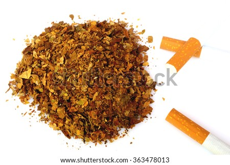 Pile of fresh tobacco and cigarettes isolated on white background - stock photo
