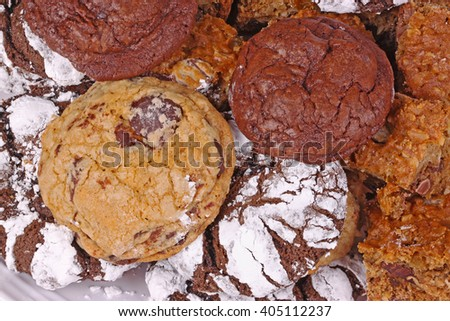 Pile of freshly baked, home-made chocolate chip, chocolate and chocolate crinkle cookies - stock photo