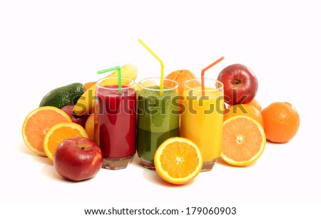 Pile of fruits and three glasses of fresh orange juice,beet and apple juice,green juice. Variety of fruits isolated on white background with fresh drinks. - stock photo