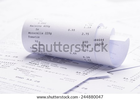 Pile Of Generic Rolled Up Receipt With Costs - stock photo