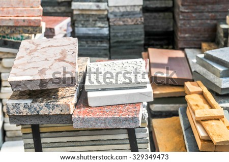 pile of granite texture - marble layers design gray stone slab surface grain rock backdrop layout industry construction - stock photo