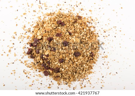 Pile of granola cereal with raisins and nuts on white - stock photo