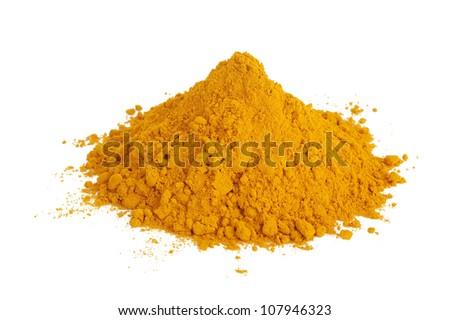 Pile of ground turmeric - stock photo