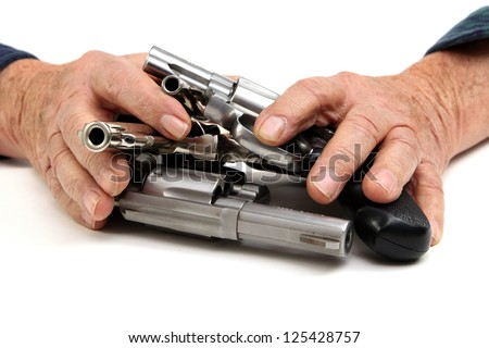 Pile of handguns, protected by the owner - stock photo