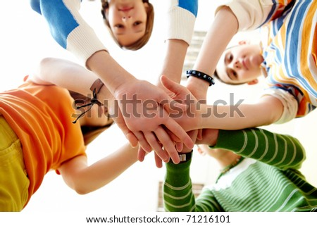 Pile of hands of friends - stock photo