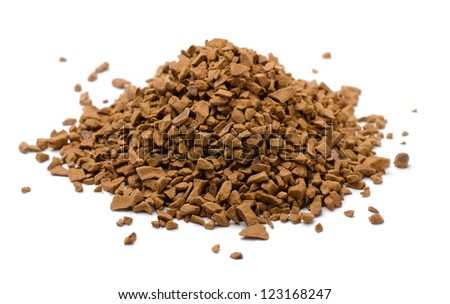 Pile of instant coffee granules isolated on white - stock photo