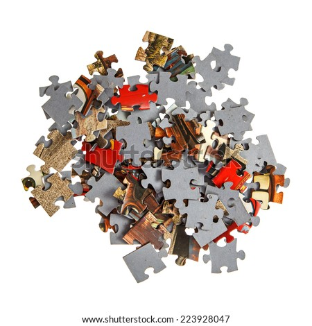 Pile of jigsaw pieces isolated over white - stock photo