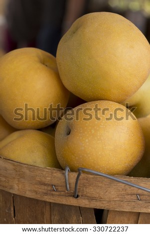 Pile of juicy ripe Asian pears at local farmers market - stock photo