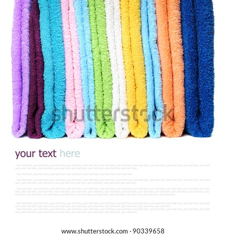 Pile of linen kitchen towels on a white background (with sample text) - stock photo