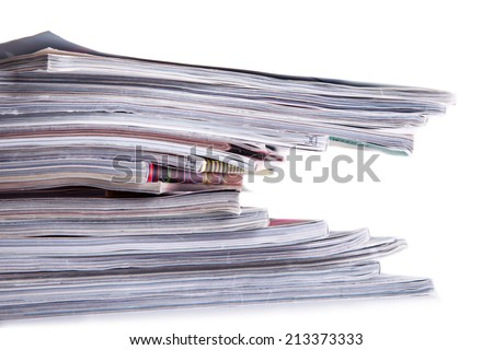 Pile of magazines on the table. - stock photo