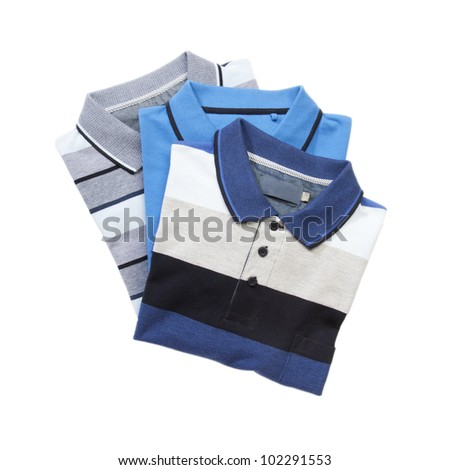 Pile of man polo shirts on white - stock photo