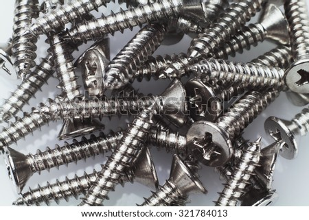 Pile of Metal Screws Background - stock photo