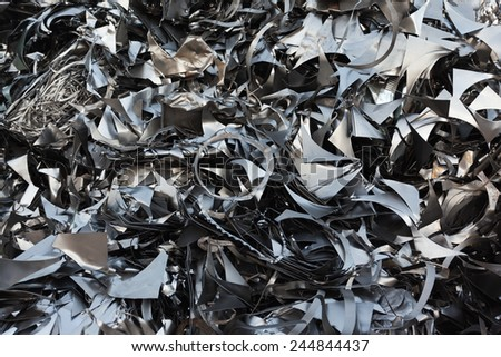 pile of metallic chips in landfill for recycling. abstract pattern - stock photo