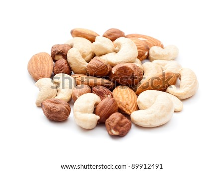 Pile of mixed nuts isolated on the white background - stock photo