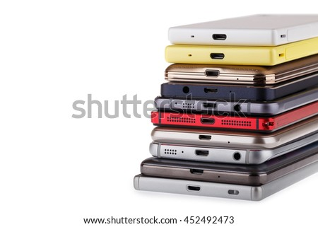 Pile of mobile phone. Heap of the different smartphones isolated on white background. - stock photo