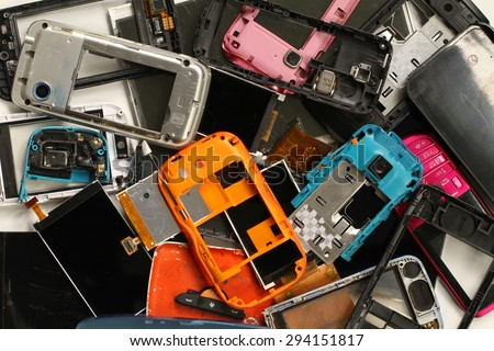 Pile of mobile phone scrap background - stock photo