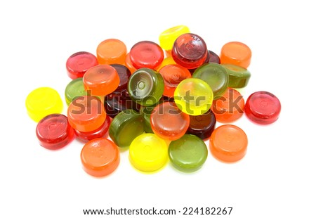 Pile of multi-coloured boiled sweets or hard candies, isolated on a white background - stock photo