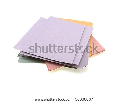 Pile of multi-coloured office paper isolated on a white background - stock photo